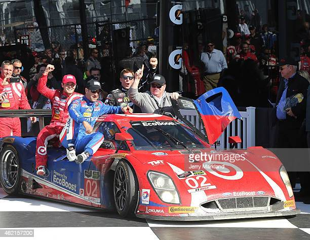 The Chip Ganassi Racing with Felix Sabates Target/Ford EcoBoost Riley driven by Scott Dixon Tony Kanaan Kyle Larson and Jamie McMurray celebrates...