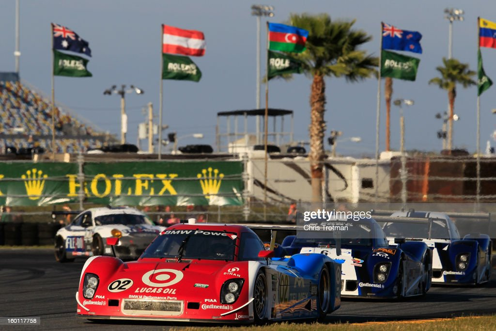 The #02 Chip Ganassi Racing with Felix Sabates Target/TELMEX Ford Riley driven by <a gi-track='captionPersonalityLinkClicked' href=/galleries/search?phrase=Scott+Pruett&family=editorial&specificpeople=541449 ng-click='$event.stopPropagation()'>Scott Pruett</a>, <a gi-track='captionPersonalityLinkClicked' href=/galleries/search?phrase=Dario+Franchitti&family=editorial&specificpeople=171306 ng-click='$event.stopPropagation()'>Dario Franchitti</a>, <a gi-track='captionPersonalityLinkClicked' href=/galleries/search?phrase=Jamie+McMurray&family=editorial&specificpeople=198964 ng-click='$event.stopPropagation()'>Jamie McMurray</a>, <a gi-track='captionPersonalityLinkClicked' href=/galleries/search?phrase=Joey+Hand&family=editorial&specificpeople=3547981 ng-click='$event.stopPropagation()'>Joey Hand</a> and <a gi-track='captionPersonalityLinkClicked' href=/galleries/search?phrase=Scott+Dixon&family=editorial&specificpeople=183395 ng-click='$event.stopPropagation()'>Scott Dixon</a> leads a pack of cars during the Rolex 24 at Daytona International Speedway on January 26, 2013 in Daytona Beach, Florida.