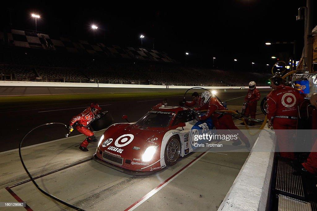 The #02 Chip Ganassi Racing with Felix Sabates Target/TELMEX Ford Riley driven by Scott Pruett, Dario Franchitti, Jamie McMurray, Joey Hand and Scott Dixon, pits during the Rolex 24 at Daytona International Speedway on January 26, 2013 in Daytona Beach, Florida.