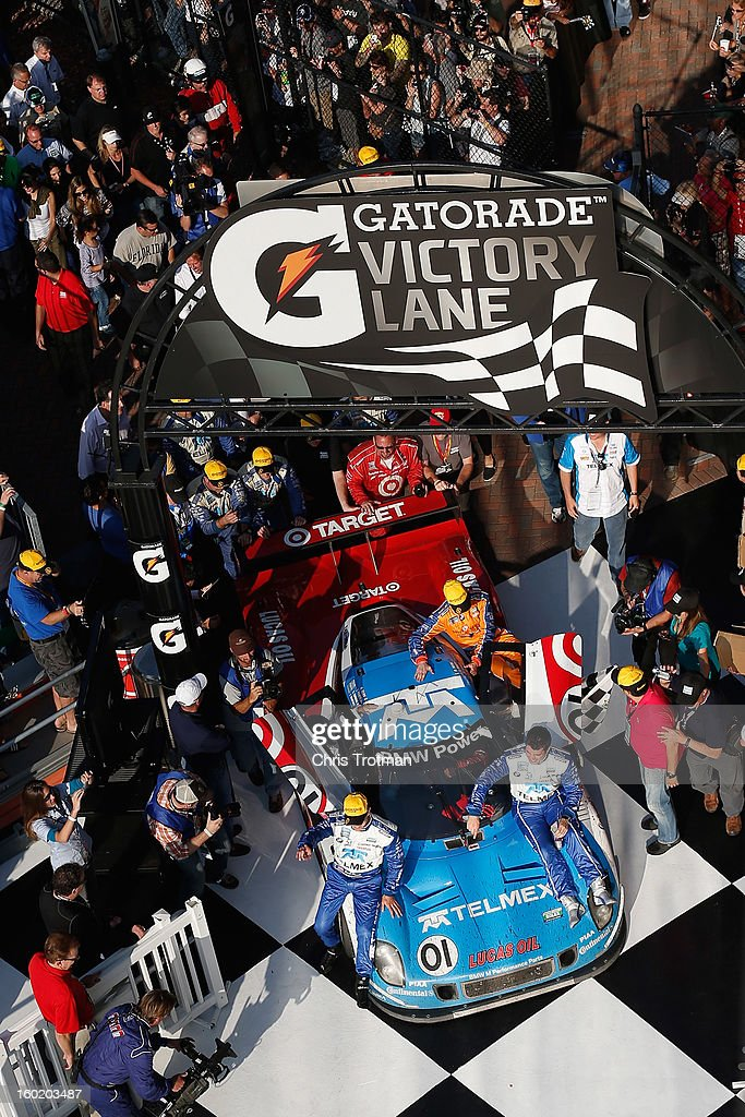 The #01 Chip Ganassi Racing with Felix Sabates TELMEX/Target Ford BMW Riley driven by <a gi-track='captionPersonalityLinkClicked' href=/galleries/search?phrase=Scott+Pruett&family=editorial&specificpeople=541449 ng-click='$event.stopPropagation()'>Scott Pruett</a>, <a gi-track='captionPersonalityLinkClicked' href=/galleries/search?phrase=Memo+Rojas&family=editorial&specificpeople=3547976 ng-click='$event.stopPropagation()'>Memo Rojas</a>, <a gi-track='captionPersonalityLinkClicked' href=/galleries/search?phrase=Juan+Pablo+Montoya&family=editorial&specificpeople=202004 ng-click='$event.stopPropagation()'>Juan Pablo Montoya</a> and <a gi-track='captionPersonalityLinkClicked' href=/galleries/search?phrase=Charlie+Kimball&family=editorial&specificpeople=7404865 ng-click='$event.stopPropagation()'>Charlie Kimball</a> ride in to victory lane at the Rolex 24 at Daytona International Speedway on January 27, 2013 in Daytona Beach, Florida.
