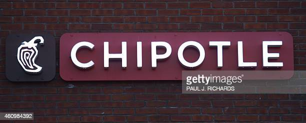 The Chipotle restaurant logo is seen in Chantilly Virginia on January 2 2015 AFP Photo/PAUL J RICHARDS