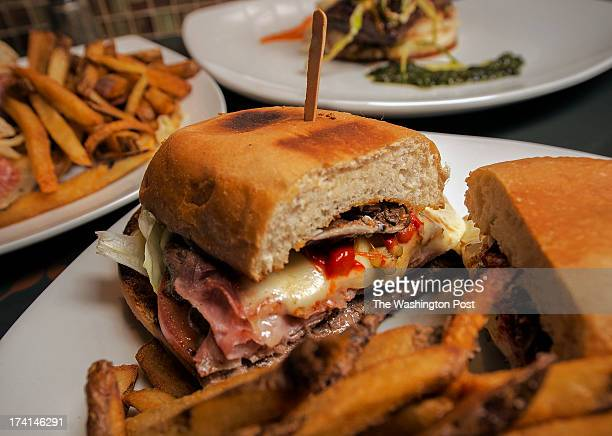 The Chivito sandwich with filet mignon ham pancetta mozzarella roasted red peppers pickle shitake olives egg boston lettuce plum tomato garlic mayo...