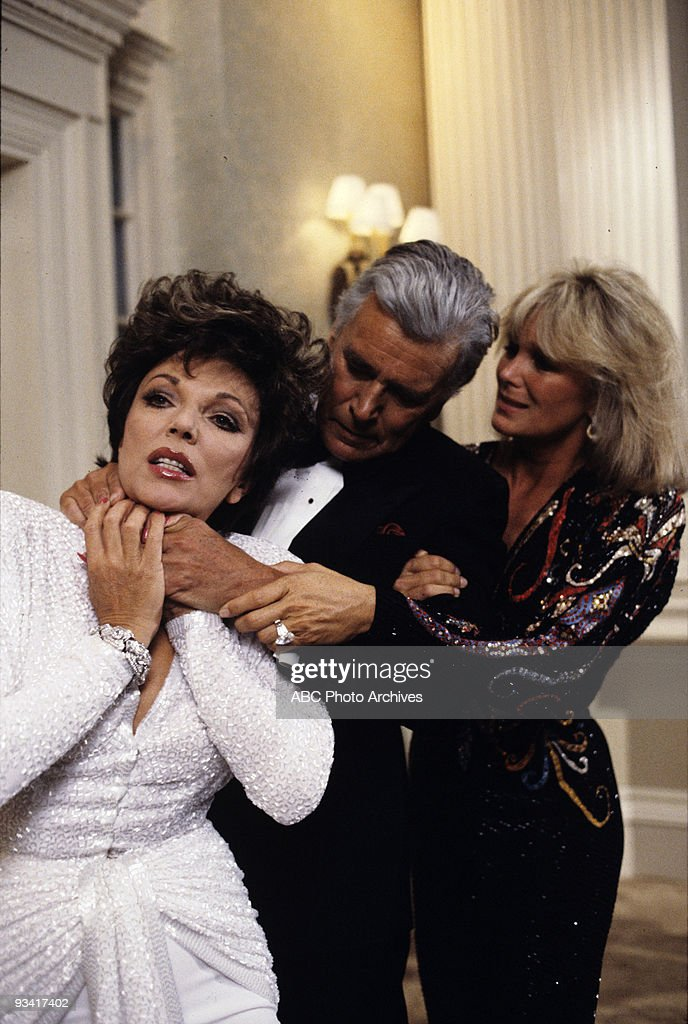 DYNASTY - 'The Choice (a.k.a) The Vendetta' - Season - 5/21/86, Krystle (Linda Evans, right) pulled a raging Blake (John Forsythe) away as he choked Alexis (Joan Collins), who had tampered with his finances.,