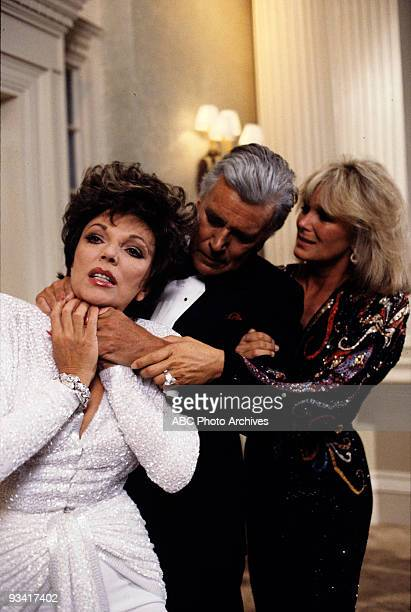 DYNASTY 'The Choice The Vendetta' Season 5/21/86 Krystle pulled a raging Blake away as he choked Alexis who had tampered with his finances