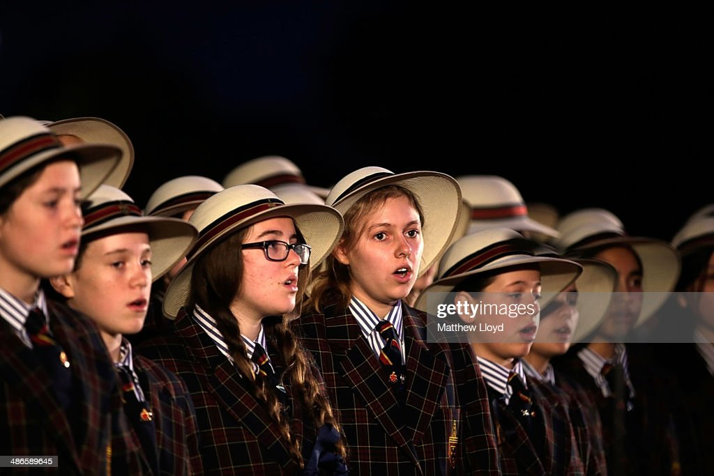 The choir of St Catherine's School, Waverley, New South Wales takes part in a dawn remembrance service at the Wellington Arch on ANZAC Day at Hyde Park on April 25, 2014 in London, England. It is the 99th anniversary of the Galipoli landings in which tens of thousands of servicemen died.