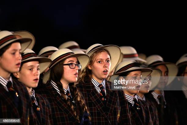 The choir of St Catherine's School Waverley New South Wales takes part in a dawn remembrance service at the Wellington Arch on ANZAC Day at Hyde Park...