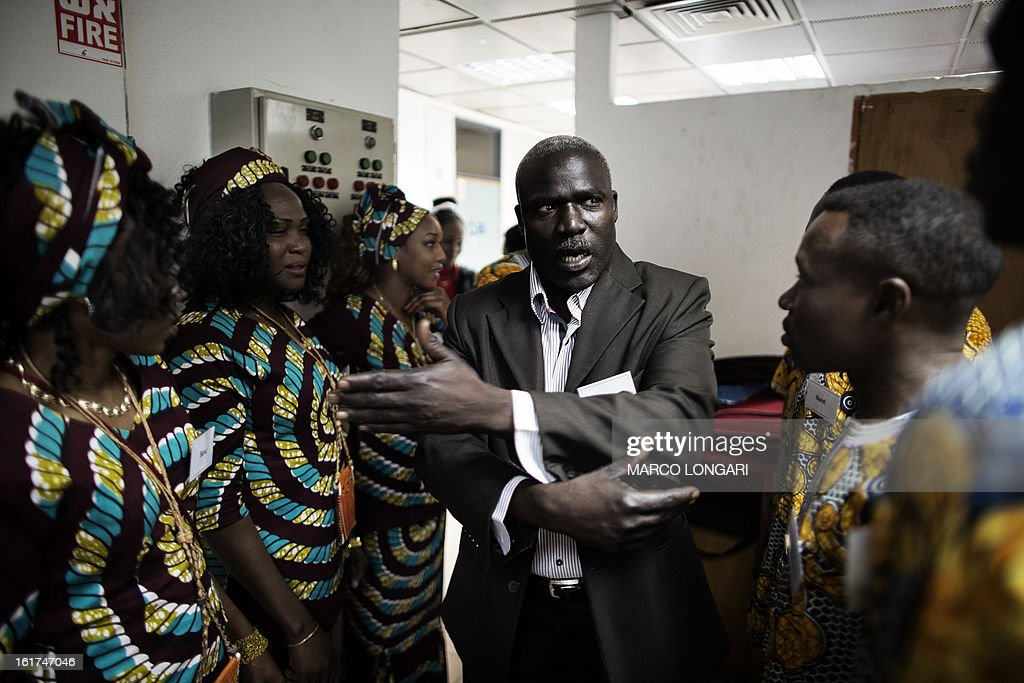 The choreographer of a dance group from the Darfur region gives his last instructions to the dancers ahead of their performance at a cultural centre in south Tel Aviv on February 15, 2013. Hundreds of Sudanese refugees take part in the cultural festival to share with local Israeli audience samples of their cultural heritage. AFP PHOTO/MARCO LONGARI