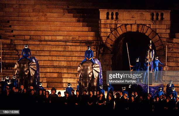 The chorus of the Arena di Verona on the stage in a scene from Aida the scenography is magnificent with golden elephants and actors wearing bright...