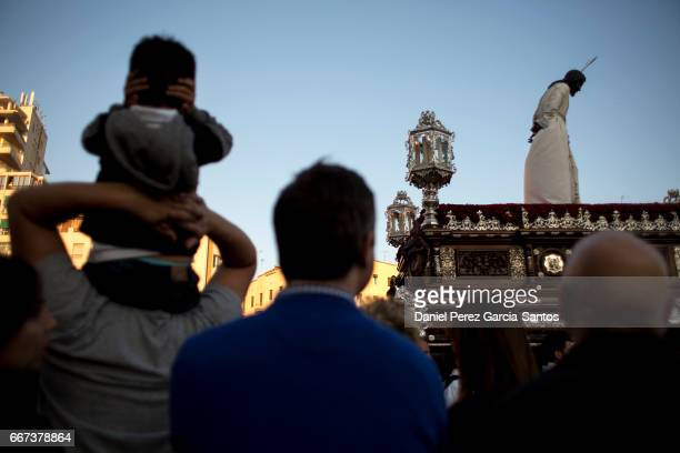 The Christ of the Estrella brotherhood is carried through the streets of Malaga during Holy Week on April 11 2017 in Malaga Spain Christian believers...