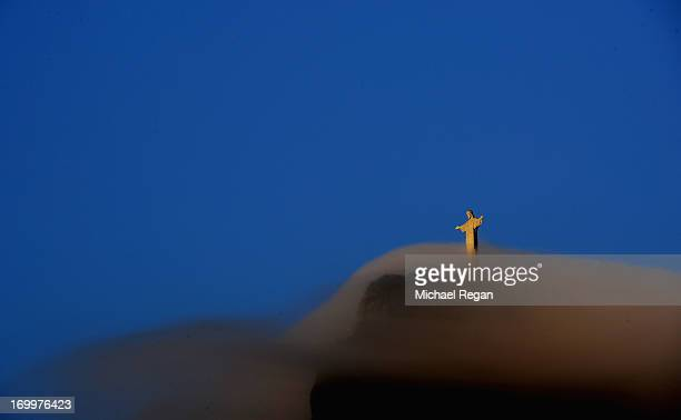 The Christ The Redeemer statue emerges from cloud at dawn ahead of the FIFA Confederations Cup Brazil 2013 on June 5 2013 in Rio de Janeiro Brazil