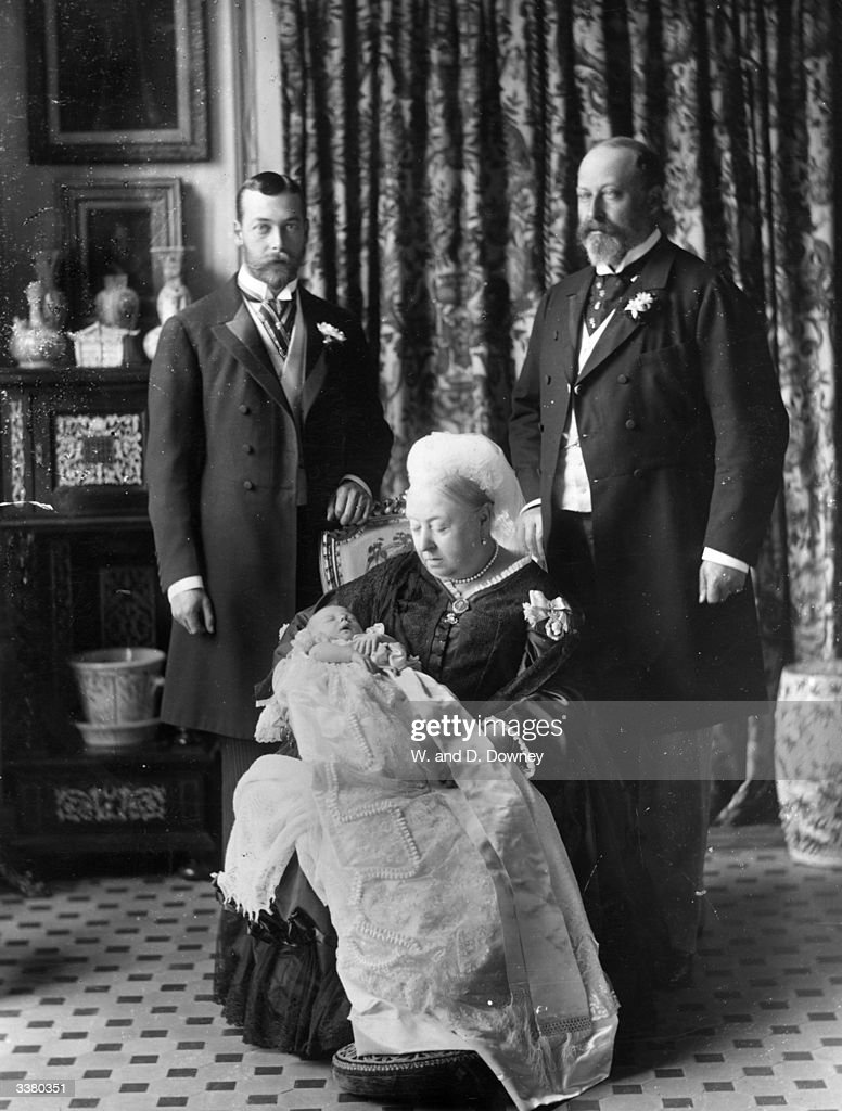 The christening of Prince Edward Albert of York (later King Edward VIII, 1894 - 1972), with his father, grandfather and great grandmother. The Duke of York (later King George V) is on the Right; the Prince of Wales (later Edward VII) is on the Left, while Queen Victoria is holding the infant.