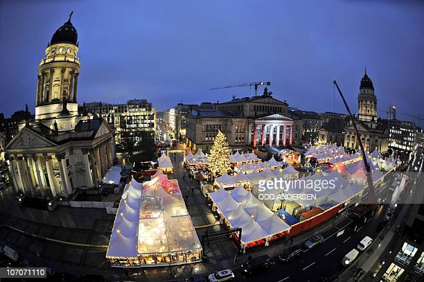 The Christmas market at Gendarmenmarkt is seen between the French Dome and the German Dome in Berlin November 22 2010 as the Christmas season starts...