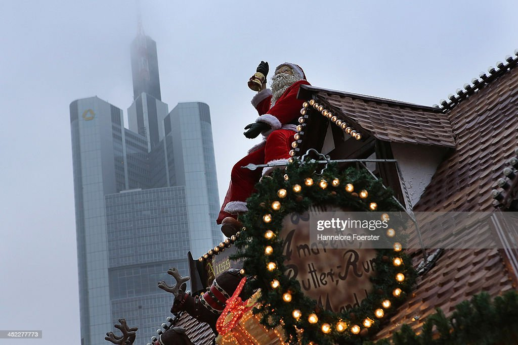 The Christmas market with the Commerzbank in the background on its opening day on November 27, 2013 in Frankfurt, Germany. Christmas markets, which traditionally sell mulled wine, stollen cake, Christmas tree ornaments and other crafts and are an essential part of German Christmas tradition, open across the country this week.