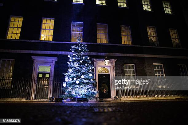 The Christmas tree outside Number 10 Downing Streetis lit up after being switched on by British Prime Minister Theresa May on December 8 2016 in...
