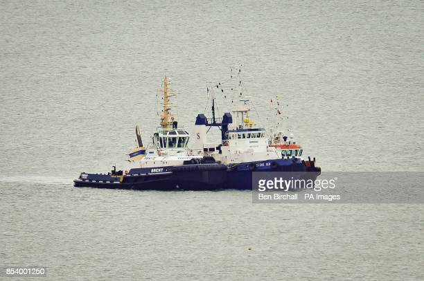 The Christos XXII pictured centre between two other tug boats which contains about 200 tonnes of diesel and is awaiting repairs before it can be...