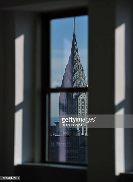 The Chrysler Building in midtown Manhattan in this view through windows in the Empire State Building February 14 2014 in New York AFP PHOTO/Stan HONDA