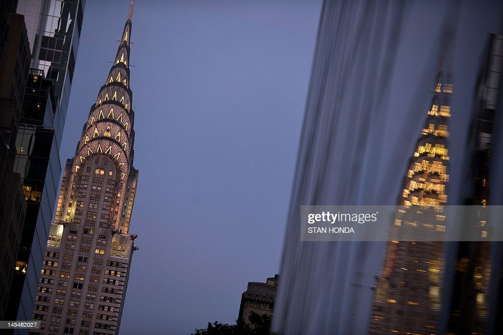 The Chrysler Building is reflected in a glass office building at dusk May 30, 2012 in New York. AFP PHOTO/Stan HONDA