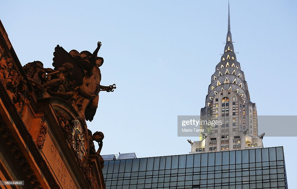 The Chrysler Building (TOP R) stands above statue of Mercury perched above the Tiffany clock at Grand Central Terminal on the day before the famed Manhattan transit hub turns 100 years old on January 31, 2013 in New York City. The terminal opened in 1913 and is the world's largest terminal covering 49 acres with 33 miles of track. Each day 700,000 people pass through the terminal where Metro-Noth Railroad operates 700 trains per day.