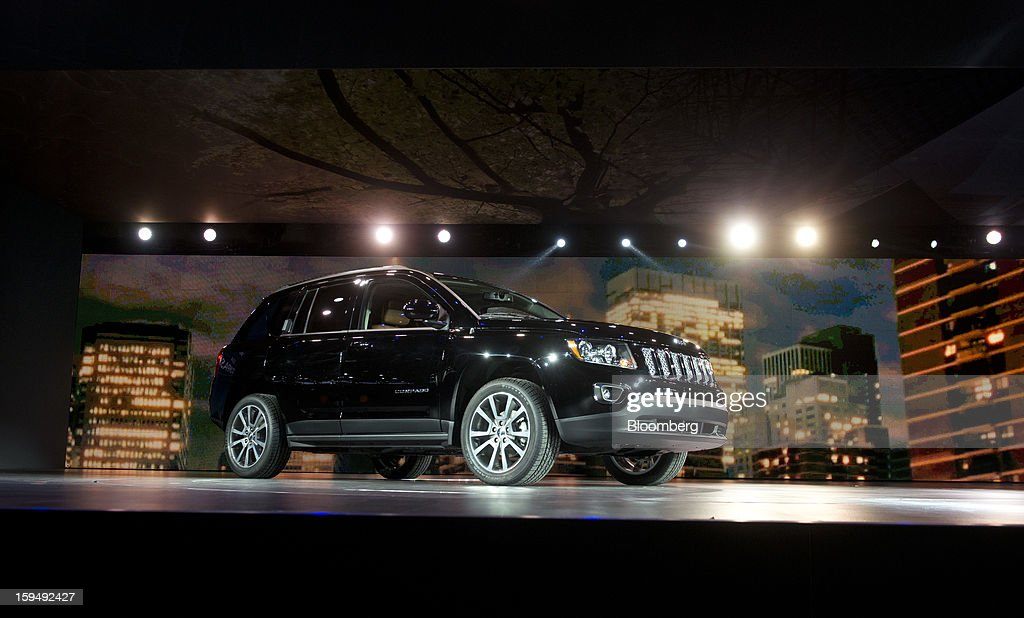 The Chrysler Group LLC 2014 Jeep Compass sits during the unveiling at the 2013 North American International Auto Show (NAIAS) in Detroit, Michigan, U.S., on Monday, Jan. 14, 2013. The Detroit auto show runs through Jan. 27 and will display over 500 vehicles, representing the most innovative designs in the world. Photographer: Daniel Acker/Bloomberg via Getty Images