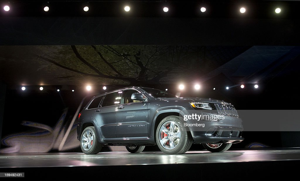 The Chrysler Group LLC 2014 Jeep Grand Cherokee SRT sits during the unveiling at the 2013 North American International Auto Show (NAIAS) in Detroit, Michigan, U.S., on Monday, Jan. 14, 2013. The Detroit auto show runs through Jan. 27 and will display over 500 vehicles, representing the most innovative designs in the world. Photographer: Daniel Acker/Bloomberg via Getty Images