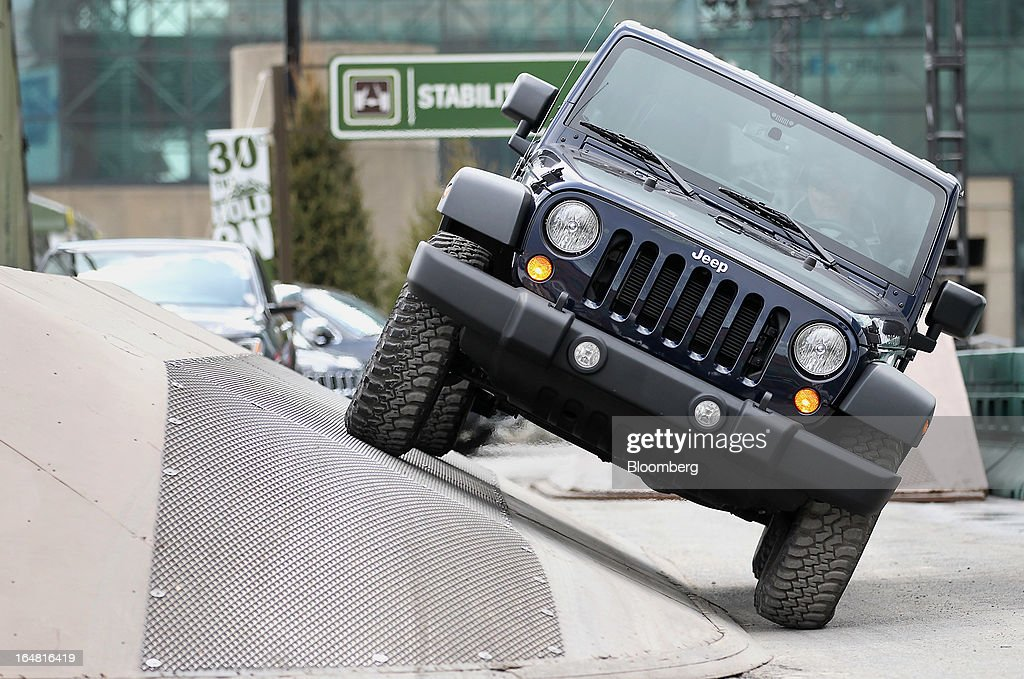 The Chrysler Group LLC Jeep Rubicon vehicle drives through the company's trail ride set up at the 2013 New York International Auto Show in New York, U.S., on Thursday, March 28, 2013. The 113th New York International Auto Show, which runs from March 29 to April 7, features 1,000 vehicles as well the latest in tech, safety and innovation. Photographer: Jin Lee/Bloomberg via Getty Images