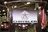 The Chrysler Group logo is attached to a podium at Chrysler's Jefferson North Assembly Plant where former Polish President and Nobel Peace Prize...