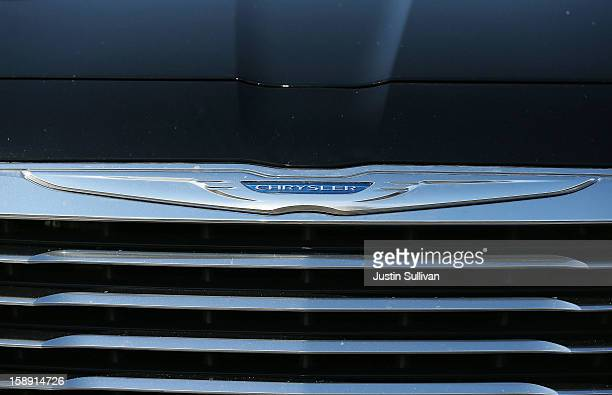The Chrysler logo is displayed on the front of a brand new car on January 3 2013 in Colma California Chrylser and General Motors led automakers in...