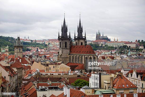 The church of Our Lady Before Tyn center and Prague cathedral right stand on the city skyline in Prague Czech Republic on Monday May 27 2013 Czech...