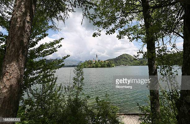The church of the Assumption of Mary a pilgrimage site and tourist attraction stands on Lake Bled Slovenia on Wednesday May 8 2013 Slovenia's...