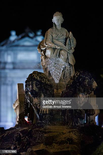 The Cibeles fountain at Cibeles square with the Alcala gate on its background on August 27 2013 in Madrid Spain This fountain and the gate behind it...