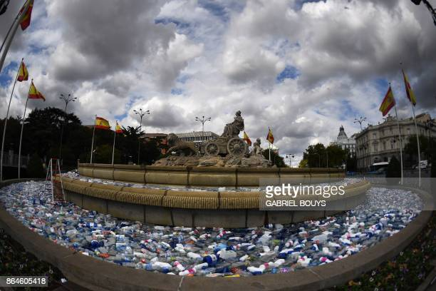 The Cibeles fountain is filled with plastic bottles for an art project by artistic group Luzinterruptus for the 'October Moon' event held in Madrid...