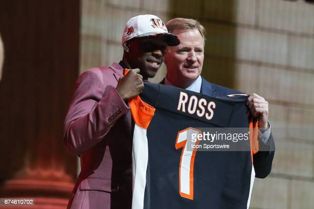 The Cincinnati Bengals select John Ross from Washington wth the 10th pick at the 2017 NFL Draft poses with NFL Commissioner Roger Goodell at the 2017...