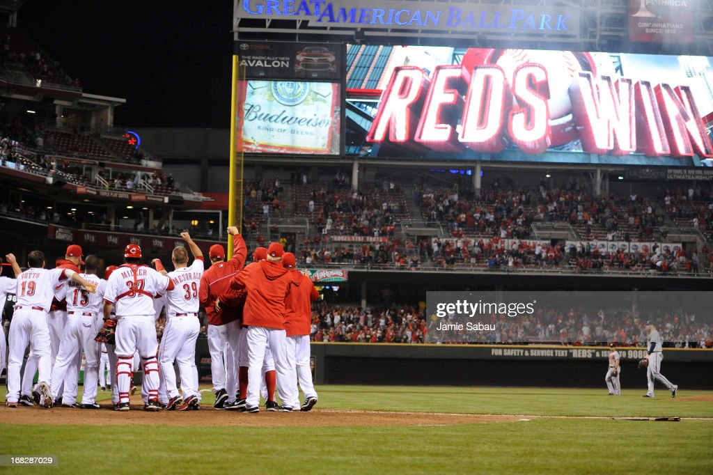 The Cincinnati Reds celebrate a ninth-inning walk off home run by <a gi-track='captionPersonalityLinkClicked' href=/galleries/search?phrase=Shin-Soo+Choo&family=editorial&specificpeople=196543 ng-click='$event.stopPropagation()'>Shin-Soo Choo</a> #17 of the Cincinnati Reds to defeat the Atlanta Braves 5-4 at Great American Ball Park on May 7, 2013 in Cincinnati, Ohio.