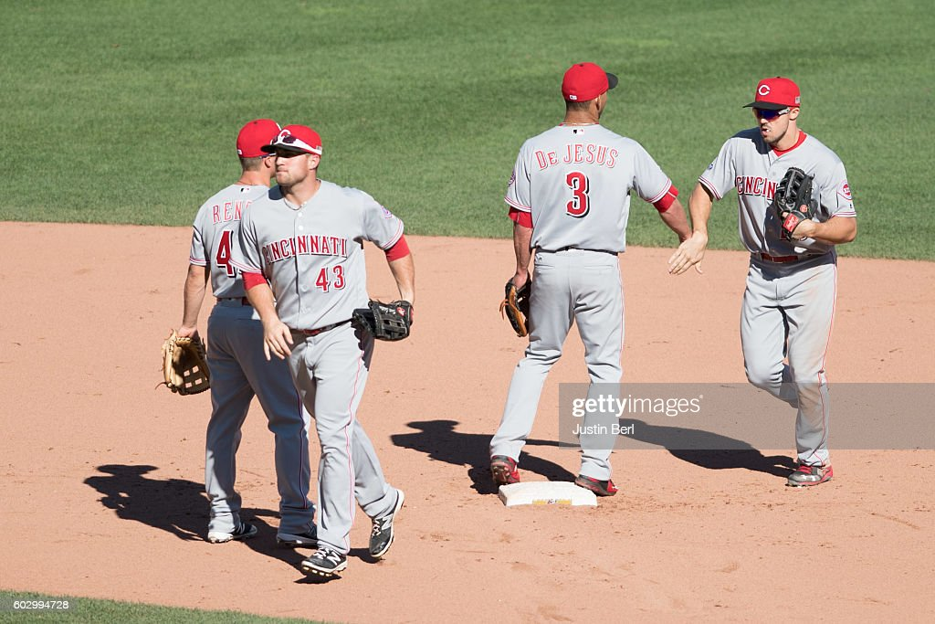 The Cincinnati Reds celebrate after the final out in their 8-0 win over the Pittsburgh Pirates at PNC Park on September 11, 2016 in Pittsburgh, Pennsylvania.