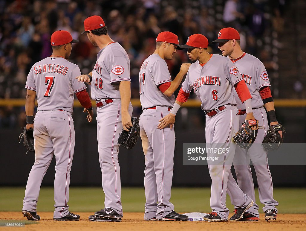 The Cincinnati Reds celebrate their 3-2 victory over the Colorado Rockies at Coors Field on August 15, 2014 in Denver, Colorado.