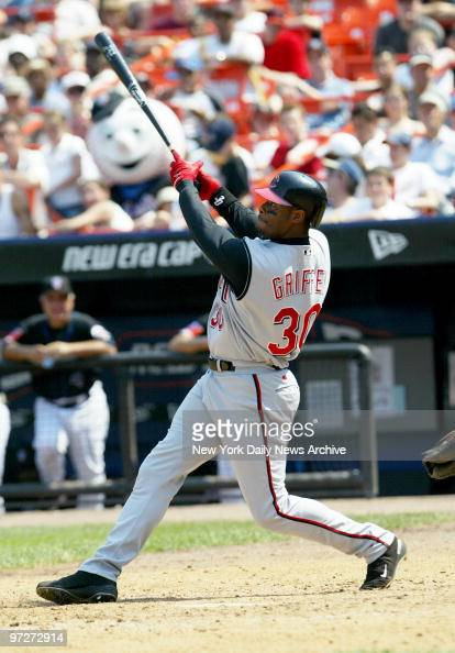 The Cincinnati Reds' Ken Griffey Jr hits a high fly ball with the bases loaded and the score 22 in the seventh inning of a game against the New York...