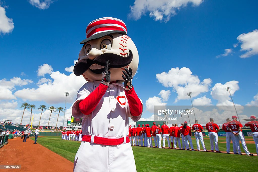 The Cincinnati Reds mascot looks on before a spring training game between the Cincinnati Reds and the Cleveland Indians at Goodyear Ballpark on March...