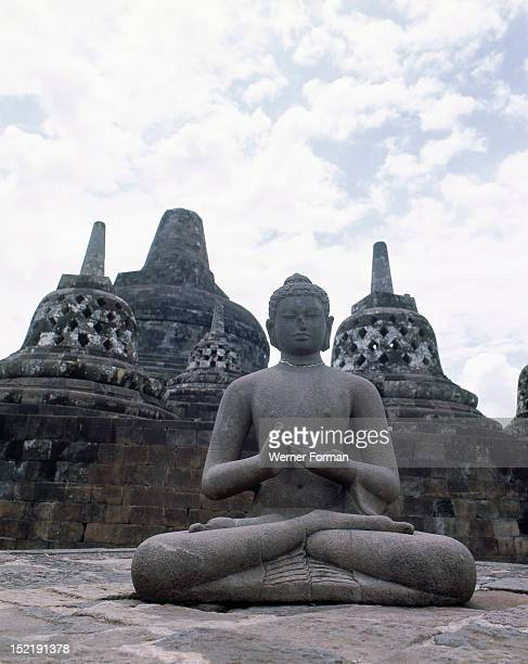 The circular terraces Borobudur Each stupa houses a figure of the DhyaniBuddha Vajrasattva in the attitude of preaching Indonesia Buddhist 8th circa...