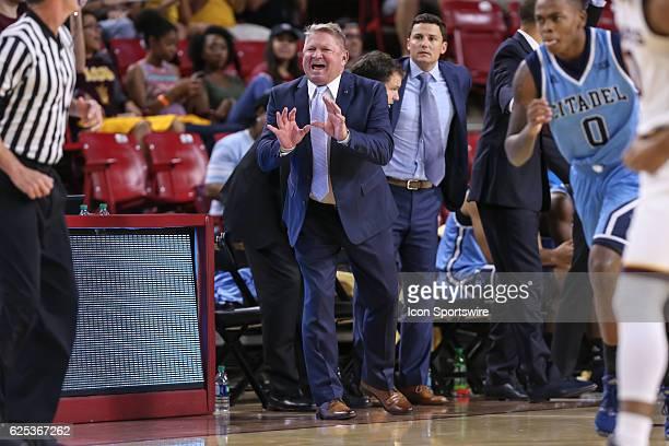 The Citadel Bulldogs coach Duggar Baucom yells at a referee during the NCAA basketball game between the Citadel Bulldogs and the Arizona State Sun...