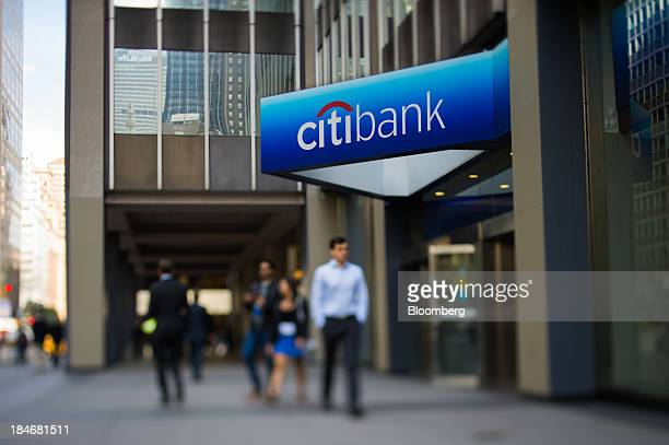 The Citibank logo as seen through a tiltshift lens is displayed above a bank branch on Park Avenue in New York US on Monday Oct 14 2013 Citigroup Inc...