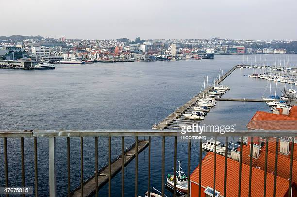 The city center is seen from a bridge across a waterway beyond yachts moored in a harbor in Stavanger Norway on Tuesday March 4 2014 Norwegians debt...