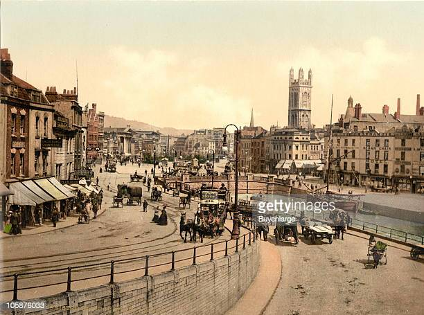 The city center of Bristol England teems with wagons carts and double decker public conveyances 1905 There are tracks and trolleys horses and a...
