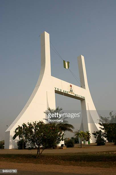 The city gate in Abuja Nigeria is seen Monday December 11 2006 OPEC the producer of 40 percent of the world's oil convenes this week in Abuja Nigeria...