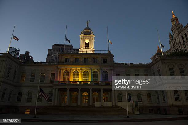 The City Hall Building is lit in the rainbow colors in New York on June 12 in reaction to the mass shooting at a gay nightclub in Orlando Florida...