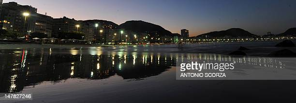 The city lights reflect on the water at Copacabana beach Rio de Janeiro Brazil on July 3 2012 Next July 6 it will be celebrated the 120th anniversary...