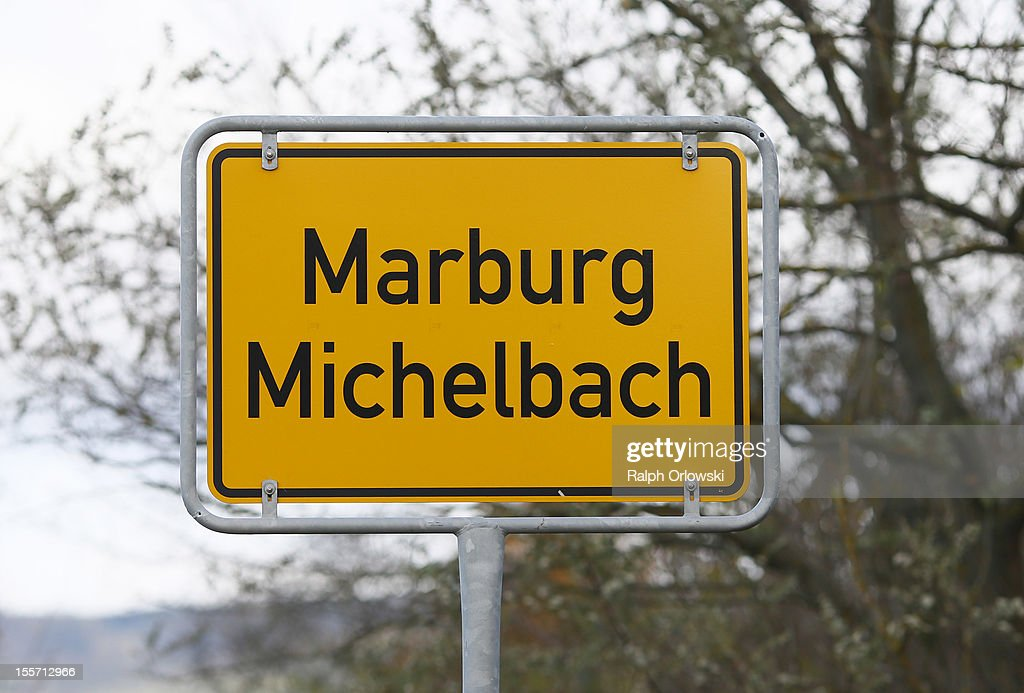 The city limit sign of Marburg Michelbach, where accused Russian spies with the aliases Andreas and Heidrun Anschlag last lived, is pictured on November 7, 2012 in Marburg an der Lahn, Germany. Anschlag and his wife, alias Heidrun Anschlag, were arrested in the fall of 2011 by German police and are scheduled to face trial in January. The couple came to Germany in 1988, reportedly as KGB spies, and continued operating for the modern Russian intelligence service while maintaining a front as immigrants from South America. Among their biggest coups was recruiting Dutch Foreign Ministry worker Raymond Valentino Poeteray, who sold them top secret NATO documents. The couple also had a daughter while living in Germany, who is now in her early 20s and reportedly knew nothing of her parents' true identity and espionage activities. German law enforcement authorities came onto the Anschlags' trail following the arrests last year of 10 Russian spies in the United States.
