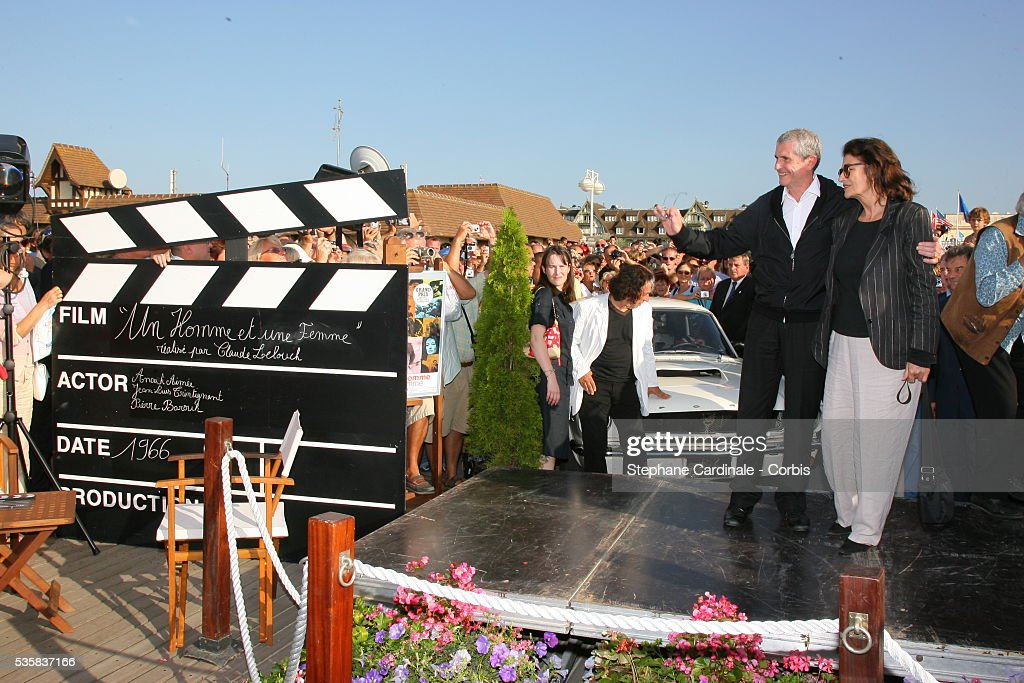 The city of Deauville pays homage to French director Claude Lelouch here with actress Anouk Aimee at the 32nd American Film Festival of Deauville