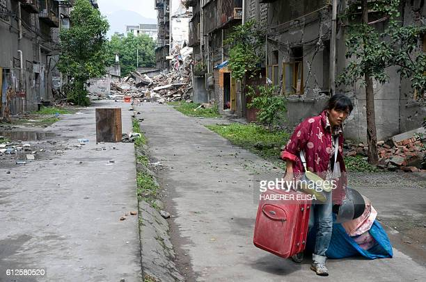 The city of Dujiangyan affected by a 79 magnitude earthquake is the most important city close to the epicentre Inhabitants return to pick up their...