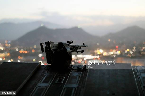 The city of Kabul can be seen at sundown from the rear deck of a US Army helicopter as it departs Resolute Support headquarters with US Defense...