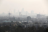 The City of London covered in smog seen from Hampstead Heath on April 10 2015 in London England Air pollution and smog has blanketed much of central...